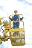 桶起重机的向上看法妇女 免版税图库摄影