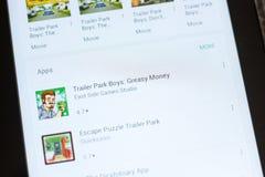 梁赞,俄罗斯- 2018年7月03日:拖车停车场男孩:在流动apps名单的油腻金钱象 免版税图库摄影