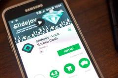 梁赞,俄罗斯- 2018年5月04日:Slidejoy在手机显示的流动app  库存图片