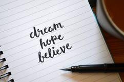梦想希望BELIEVE手有学问在笔记本 免版税库存图片