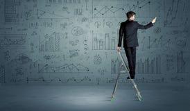 梯子图画图的人 免版税库存图片