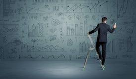 梯子图画图的人 免版税图库摄影