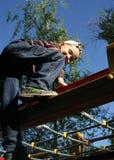 梯子的孩子在游乐园 免版税图库摄影