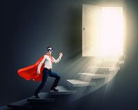 梯子的超人 免版税图库摄影
