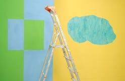 梯子被绘的墙壁 免版税库存图片
