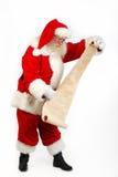 检查他的列表圣诞老人 免版税图库摄影