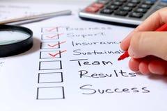 检查企业概念的现有量 免版税图库摄影