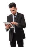 检查在他的ipad的商人数据 库存照片