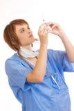 检查女性被装载的护士注射器年轻人 图库摄影