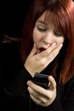 检查的女孩移动电话 免版税库存照片