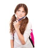 检查的聪明的体贴的女孩 免版税库存照片