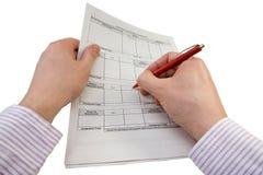 检查语句税务的生意人 免版税库存照片
