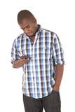 检查他的电话的非裔美国人 免版税库存图片