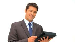 检查他的触摸板的商人根据白色背景 股票视频