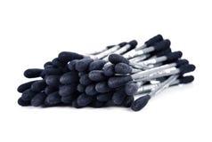 棉花棍子,黑颜色 免版税库存图片
