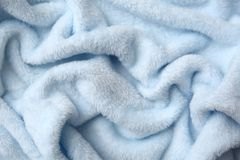 棉花毯子有有趣的纹理的和不规则地弄皱用一个相当艺术性的方式 免版税图库摄影