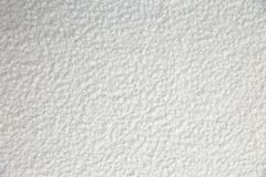 棉花毯子有有趣的纹理的和不规则地弄皱用一个相当艺术性的方式 库存图片