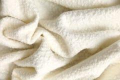 棉花毯子有有趣的纹理的和不规则地弄皱用一个相当艺术性的方式 库存照片