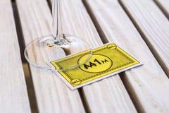棋一百万的黄牌在一块玻璃下的在a 免版税图库摄影