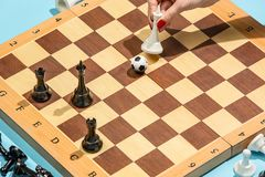 棋子足球在委员会的 免版税库存照片
