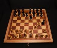 棋形象的抽象构成 查出在黑色背景 库存照片