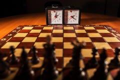 棋枰、时钟和图 库存照片