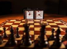 棋枰、时钟和图 免版税库存图片