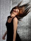 棍打跳舞迪斯科性感的妇女 免版税库存照片