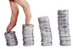 棒上升的硬币 免版税库存图片