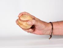 棒球在手中 免版税库存照片