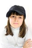 棒球帽女孩 免版税库存图片