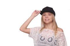 棒球帽的被隔绝的小姐 免版税库存图片