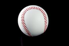 棒球有棕色背景 免版税库存照片
