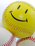 棒球表面面带笑容 库存照片