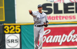 棒球防御游击手投掷 免版税库存图片