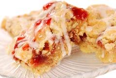 棒蛋糕咖啡胡桃草莓糖粉奶油细末 库存照片