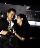 棒香槟夫妇 免版税库存图片
