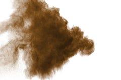棕色尘末爆炸的结冰行动 停止棕色粉末的运动 免版税库存图片