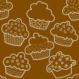 棕色杯形蛋糕概述无缝 免版税图库摄影