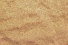 棕色海滩沙子纹理,暑假背景顶视图  库存照片