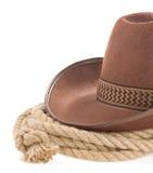 棕色牛仔帽绳索白色 库存图片