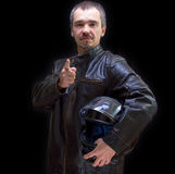 棕色皮夹克的成人摩托车骑士。 库存图片