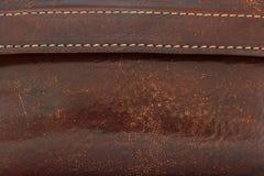 从棕色皮肤的钱包片段 库存照片