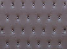 棕色皮革位子室内装饰品的样式 免版税库存图片