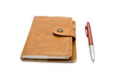 棕色皮革笔记本笔 库存图片