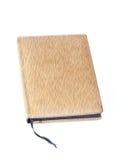 棕色盖子被印的笔记本皮肤 库存图片