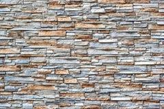 棕色石头墙壁  石墙纹理背景自然颜色 免版税库存照片