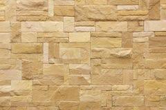 棕色石头铺磁砖了墙壁 图库摄影