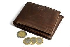 棕色硬币查出钱包白色 免版税库存照片