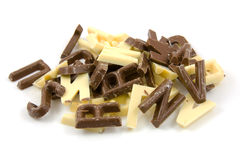 棕色糖果巧克力在白色上写字 免版税图库摄影
